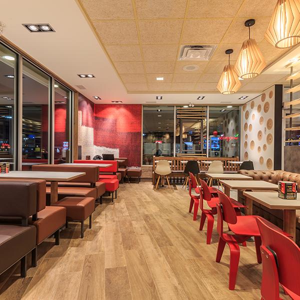 McDonald's Wood & Stone Restaurant Installation - Custom Dining Furniture