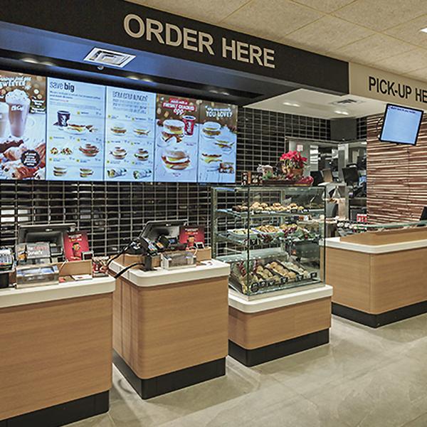 McDonald's Wood & Stone Restaurant Installation - Custom Hospitality Furniture